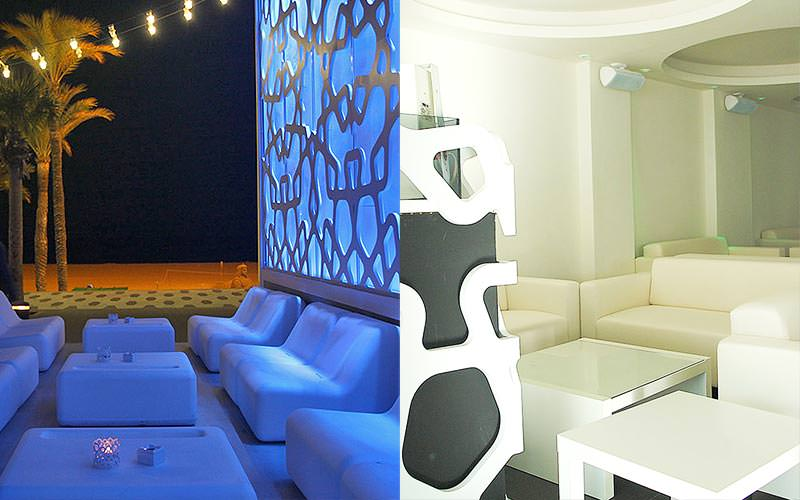 A split image of some seats outside at Moon Club at nighttime and some white seats indoors in Moon Club