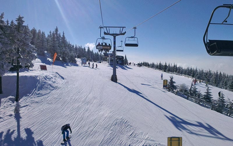 Some cable cars taking skiers up to the top of the slopes