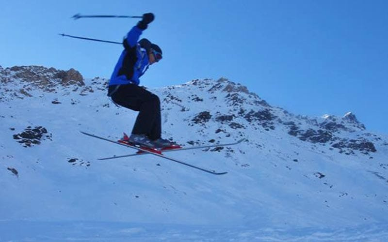 A man getting some air on his skis