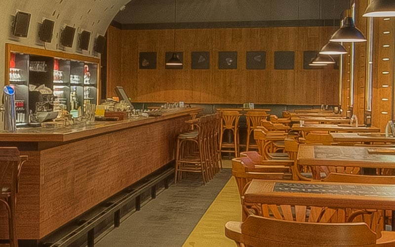 The restaurant area with wooden tables in Staropramen Brewery