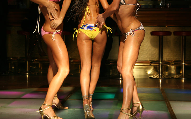 Three women wearing bikinis