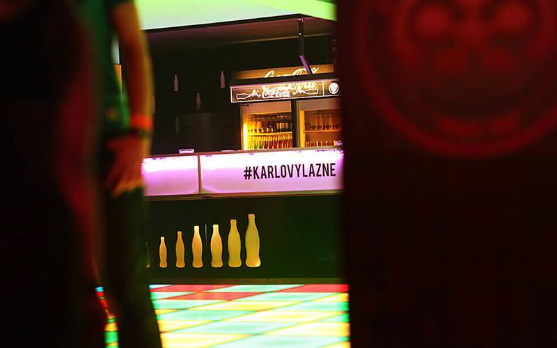 Karlovy Lazne text on the lit-up bar counter