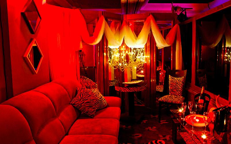 A plush, red seating area in Goldfingers