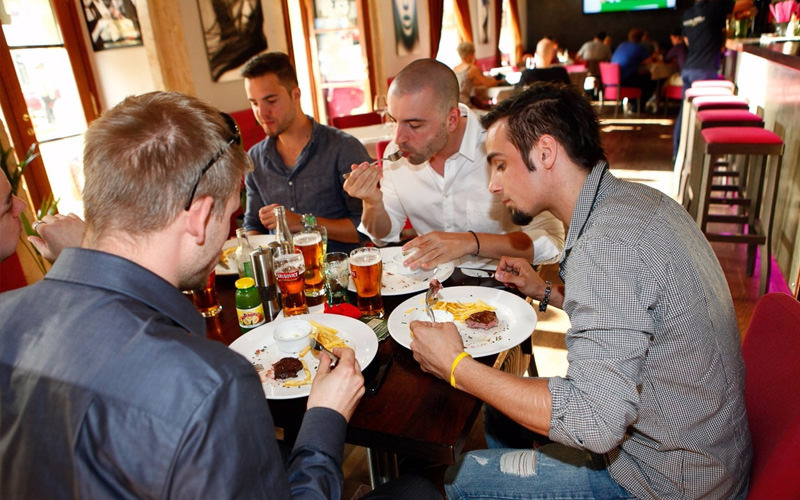 A group of men enjoying a meal around a table