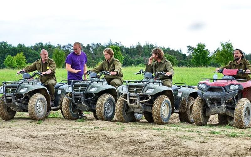 Some people receiving quad biking tuition