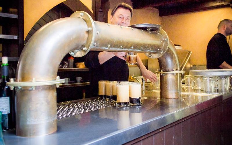 A man inside Ufleku Brewery, pouring pints