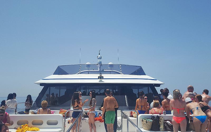 People stood on the top deck of a boat