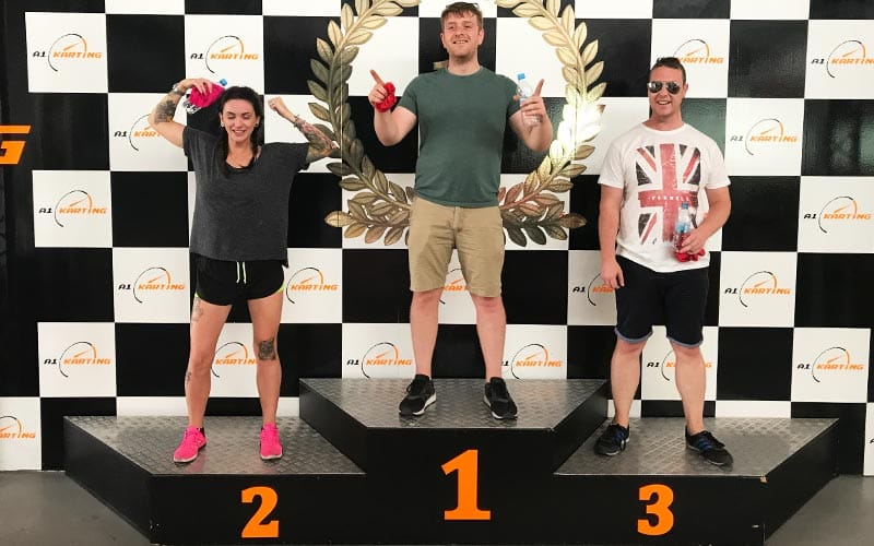 A podium presentation of the best drivers at A1 karting's indoor track