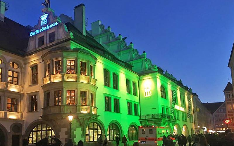 The Hofbrauhaus lit up green at night
