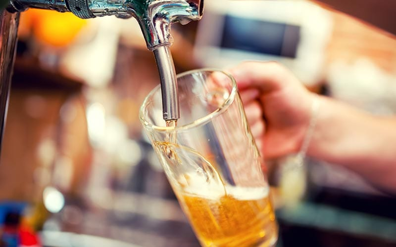 Image of a pint of beer being poured into a glass