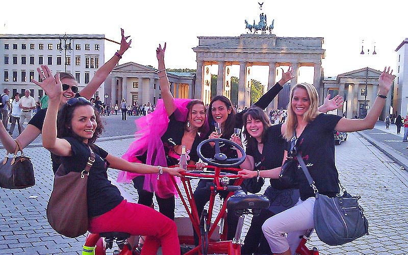 Some girls on a hen party, riding a conference bike