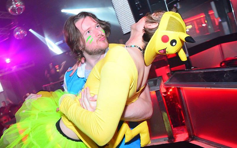 A man carrying a man dressed as Pikachu