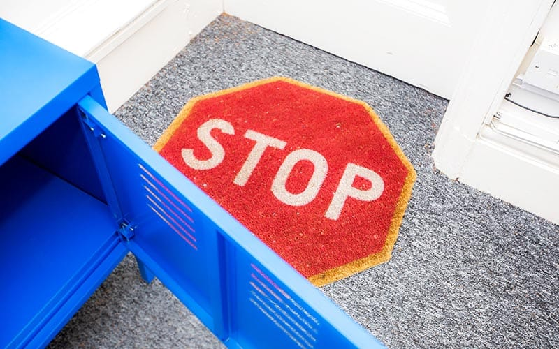 A stop sign on the carpet at the Escape Room