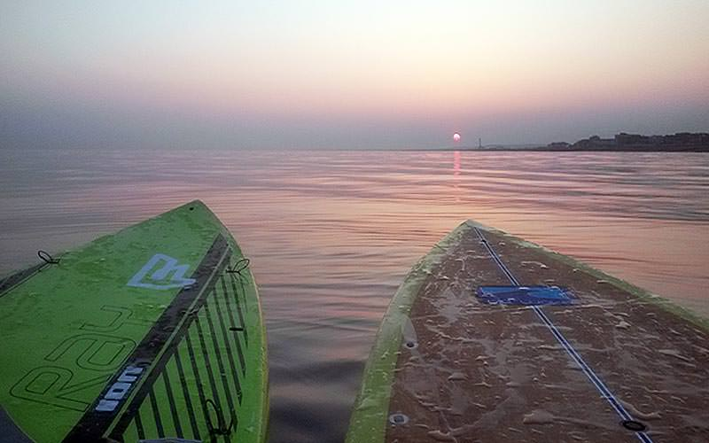 Two paddle boards on the sea