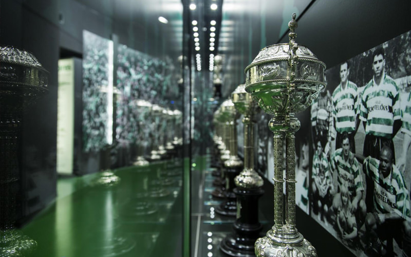 A row of trophies in a large green room