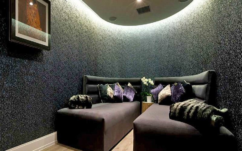 A relaxation room with black walls