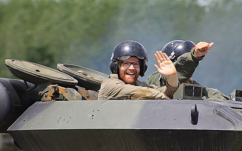 A man waving from a tank