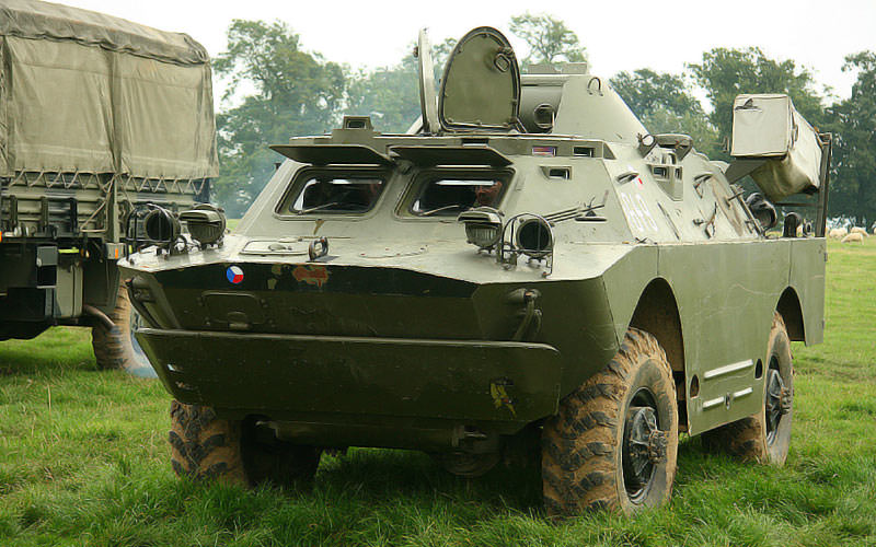 Two military vehicles in a field