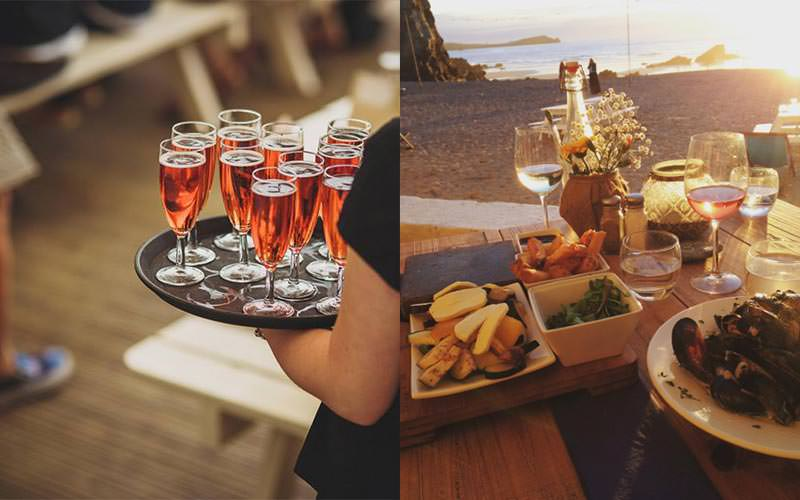 A split image of a woman carrying glasses of rose prosecco and a lovely meal laid out on a wooden table on the beach