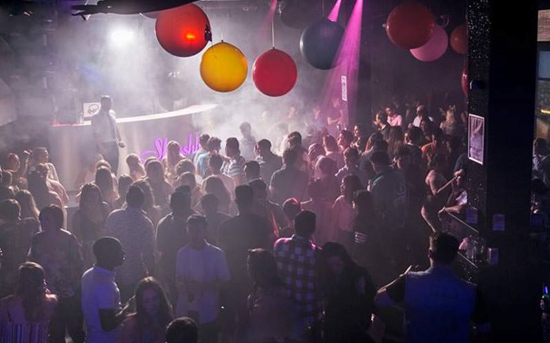 Balloons suspended above a packed dance floor