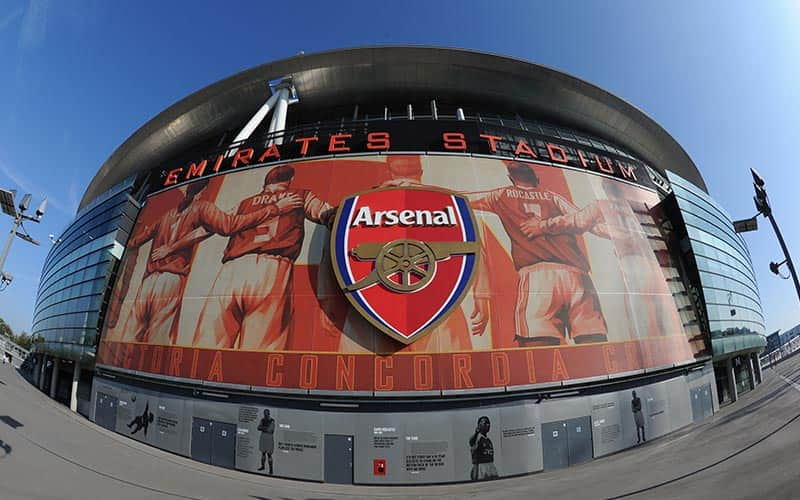 An Arsenal badge on the exterior of the Emirates Stadium