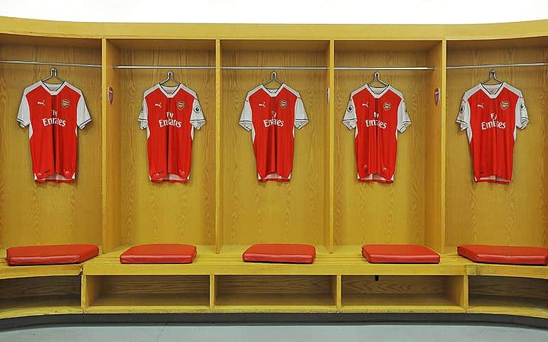 Arsenal shirts hung on the wall in the player's dressing room