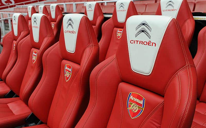 The red seats in the dugout at Emirates Stadium