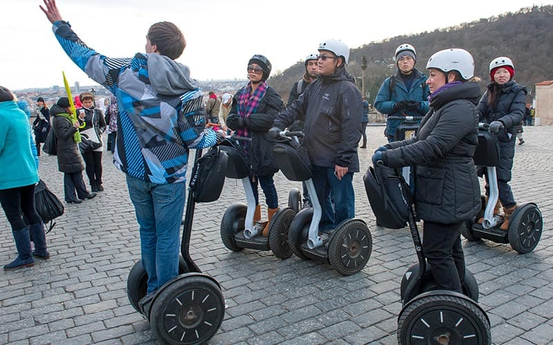 People receiving segway tuition
