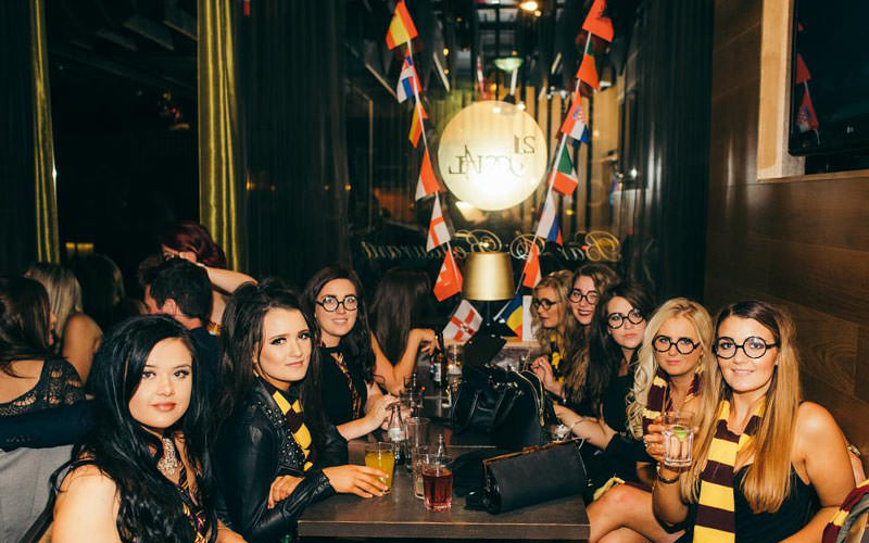 Women in Harry Potter themed costumes, sat at a table in 21 Social, Belfast