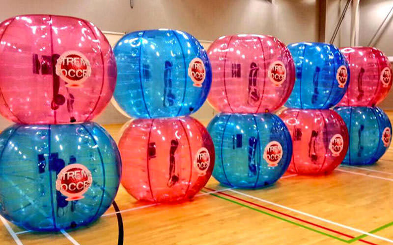 Eight zorbs stacked up in twos, in a leisure centre
