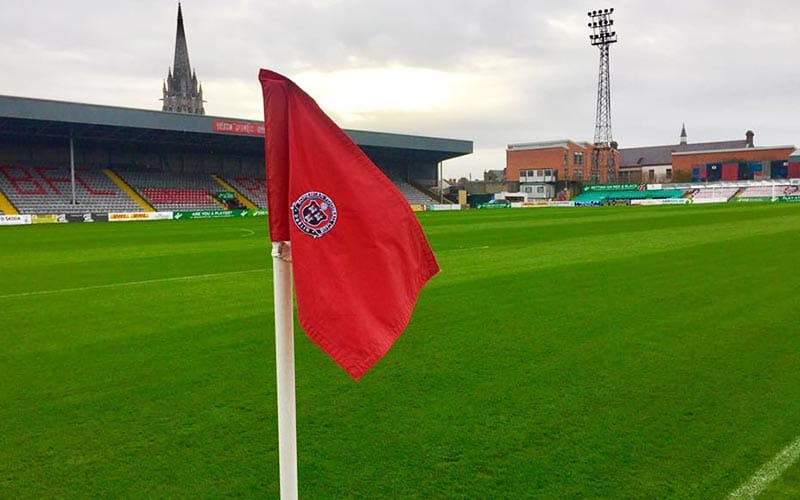 A red flag on the sideline of Bohemian FC's football pitch