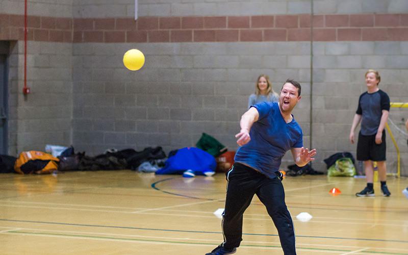 A man throwing a dodgeball