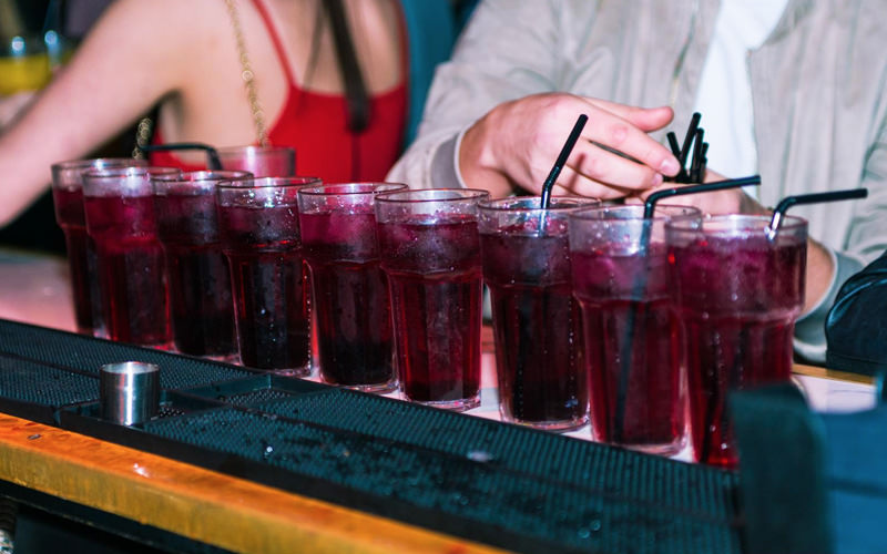 A row of drinks on the bar