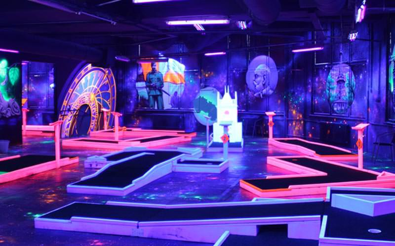 The glow golf arena illuminated with UV lights