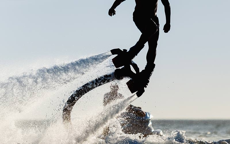 Close up of a man on a flyboard in the sea