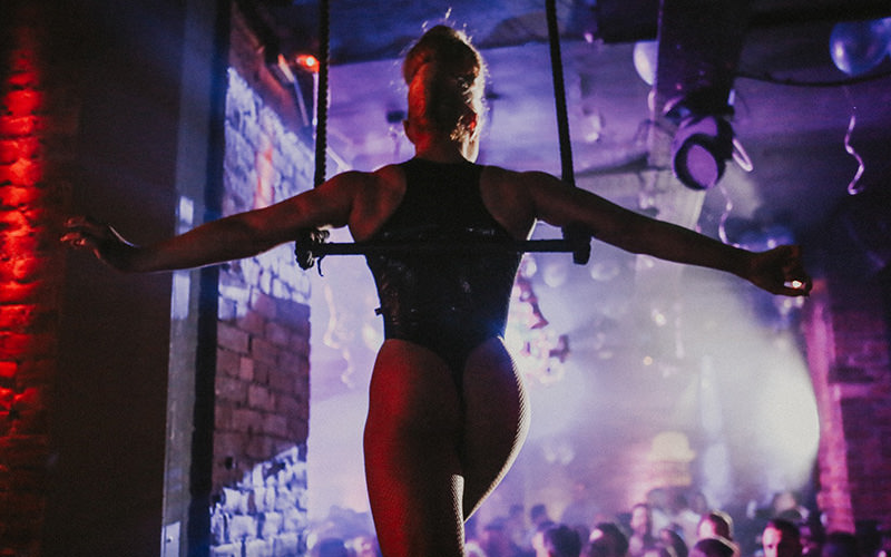 A woman performing on stage in a nightclub