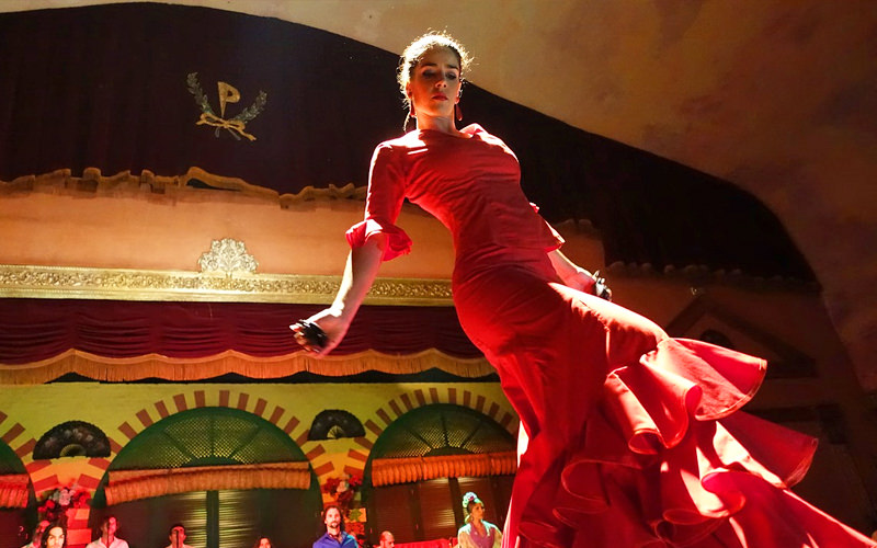 A woman dancing in a red dress