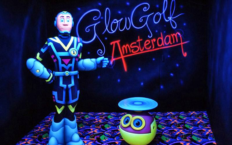 A small robot and another ornament at Glow Golf, Amsterdam