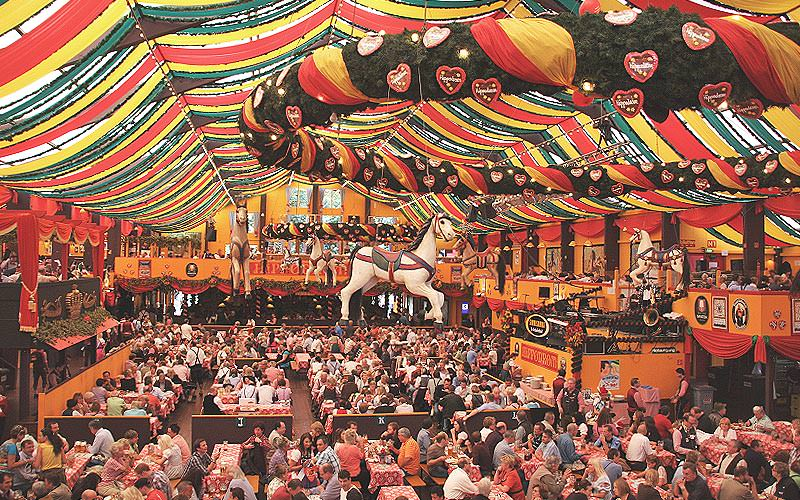 People sat in a huge beer tent at Oktoberfest