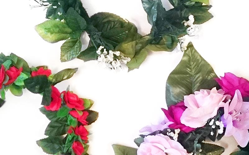 Close up of three artificial flower headbands