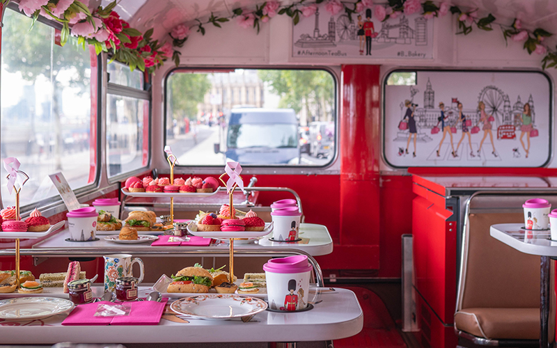 Afternoon tea set up on a bus, with other tables and chairs in the background