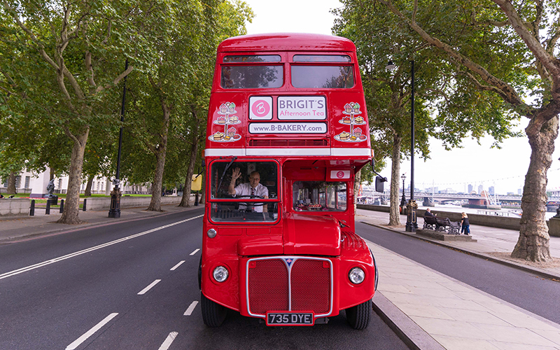 The red double decker, afternoon tea bus on the road
