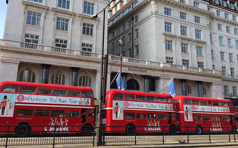 Three red double deckers, parked up