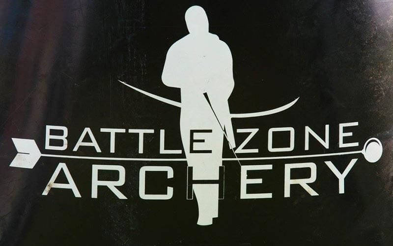White BattleZone Archery logo on a black background.