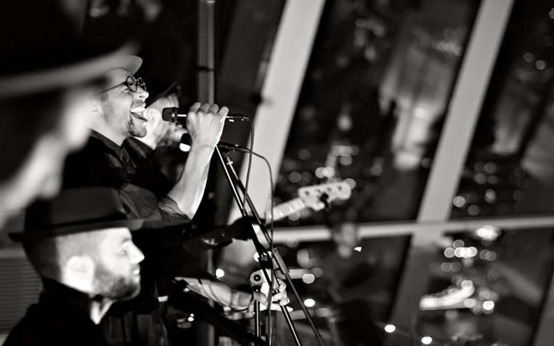 Band playing, singer singing, black and white image