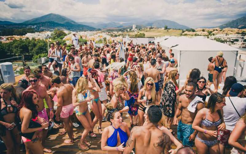 People dancing at Sisu pool party in the day