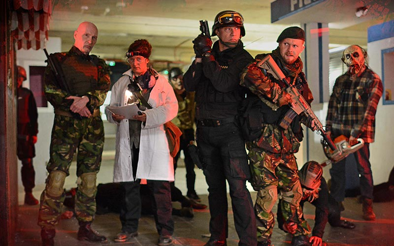 A group of people dressed in soldier uniforms and a doctor