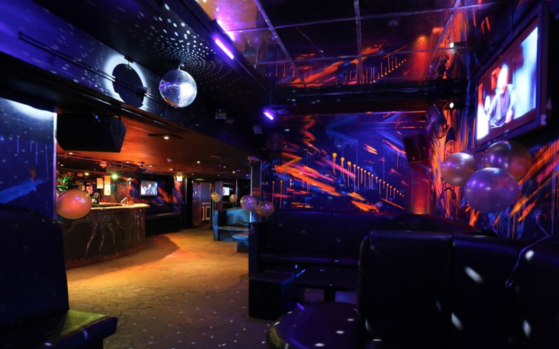 A venue with bright colours and flashing lights