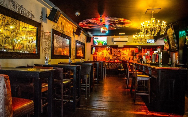 A well lit bar in a nightclub