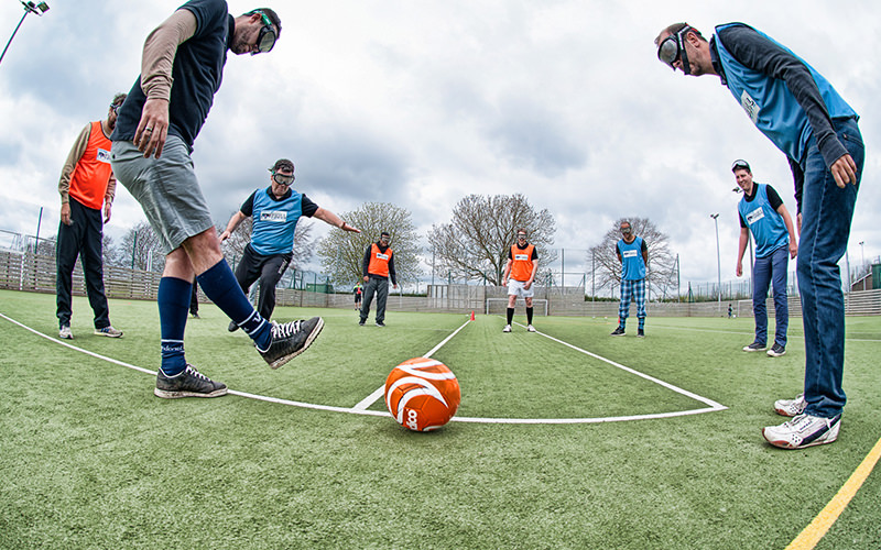 A group playing goggle football